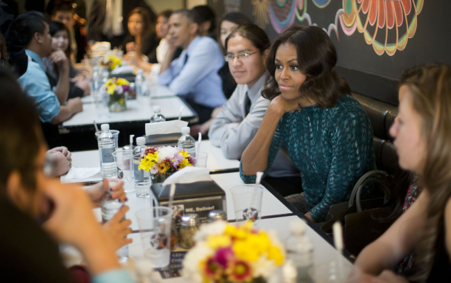 First lady Michelle Obama, and President Barack Obama have lunch with members of the Standing Rock Sioux Tribal Youth at We the Pizza/Good Stuff Eatery restaurant in the Capitol Hill neighborhood of Washington, Thursday, Nov. 20, 2014. (AP Photo/Pablo Martinez Monsivais)